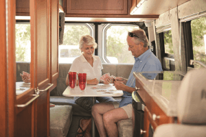couple playing cards in rv